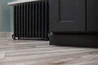 Painted floor heater contrasting beautiful hardwood floors