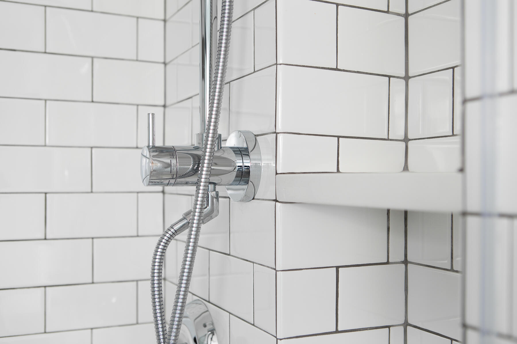 Classic white subway tile make a small bathroom feel larger