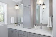 Classic style in this master bath remodel in Libertyville, Illinois with light gray cabinetry, chrome hardware and white countertops.