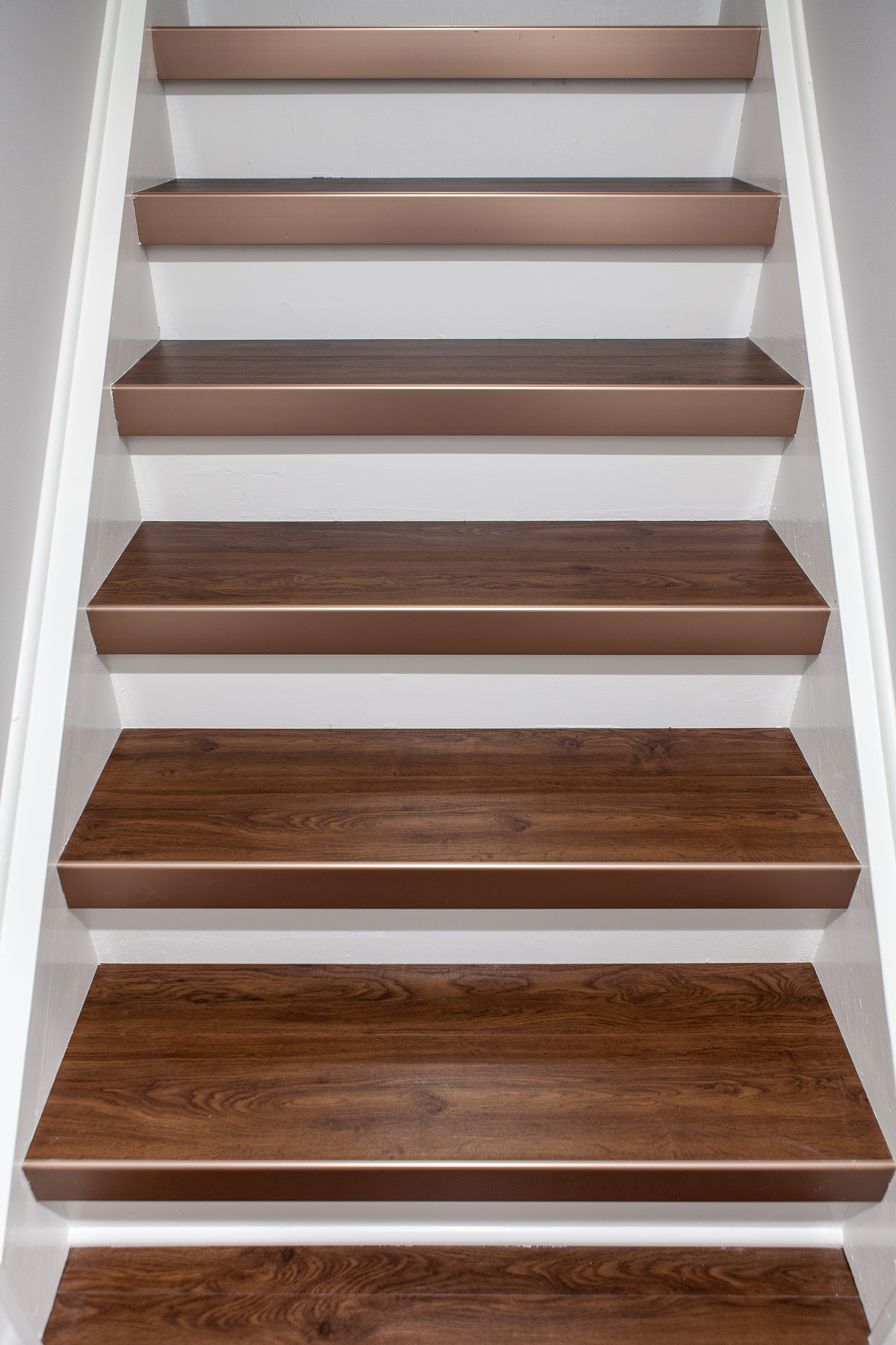 White trim and beautiful hardwood stairs