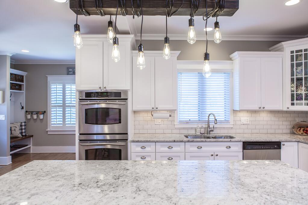Lighting with personality - beautiful remodeled kitchen
