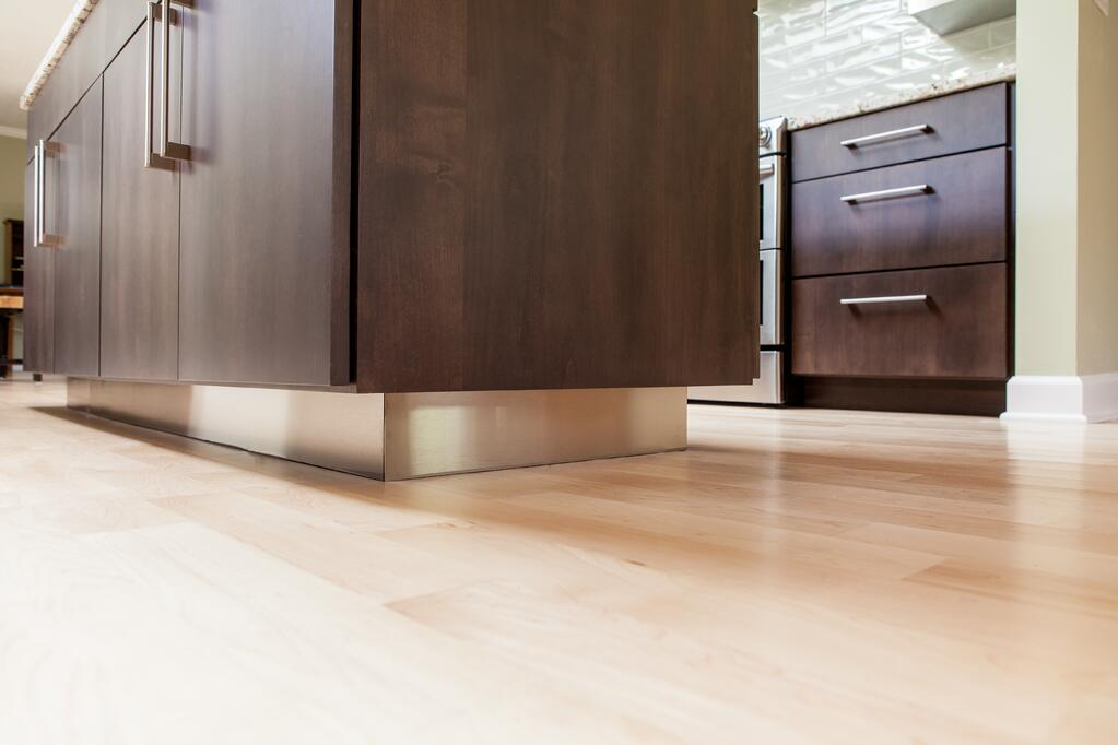 Light hardwood flooring and manicured cabinetry