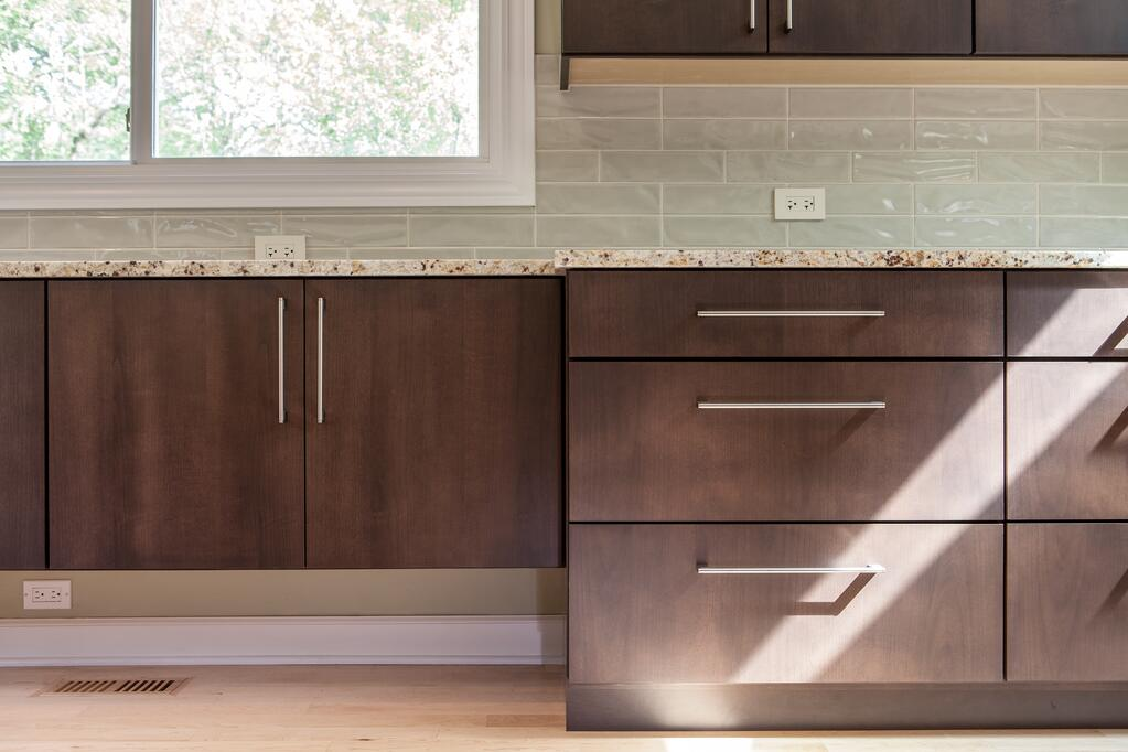 Flat panel cabinetry and subway tile backsplash