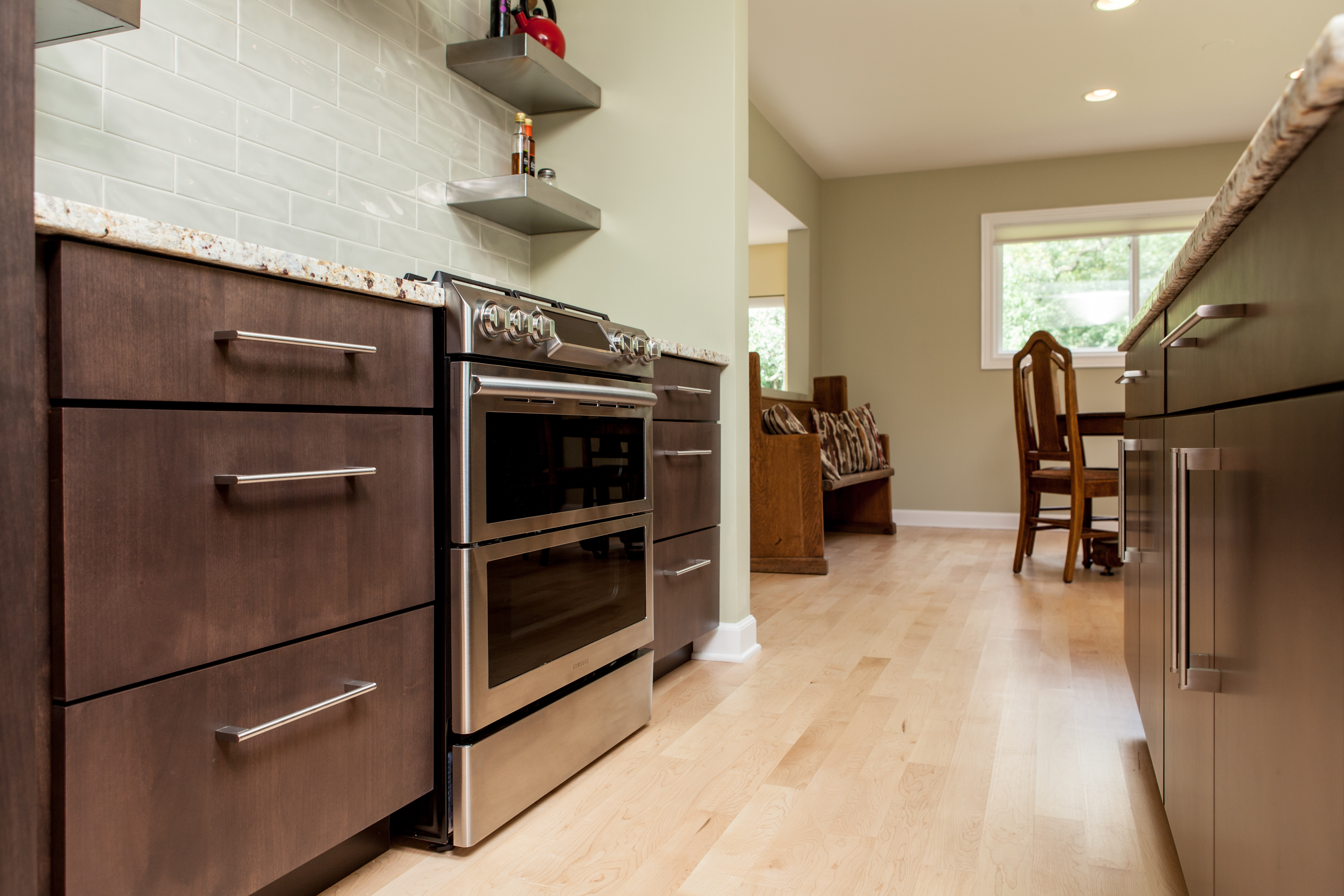 Light hardwood flooring makes a perfect contrast for dark wood cabinets