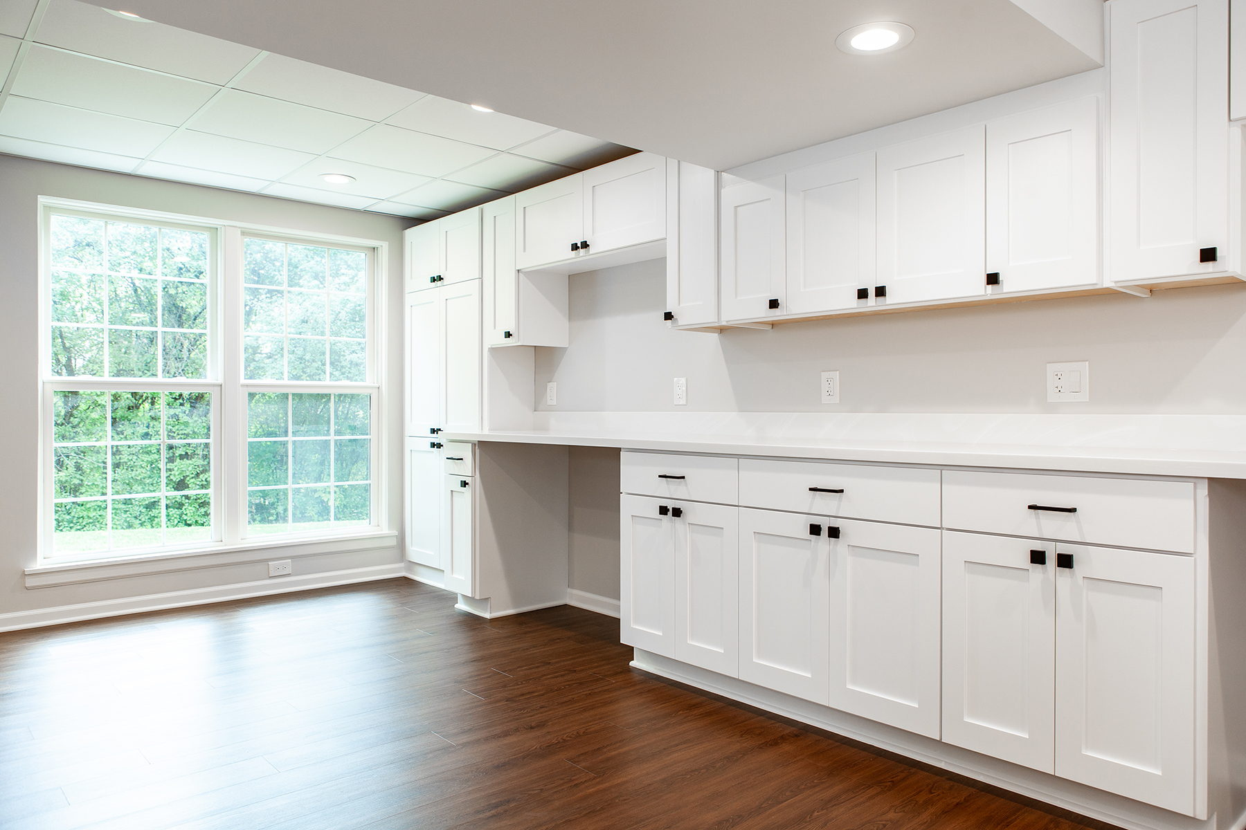 Basement remodel with lots of natural light and custom cabinetry.