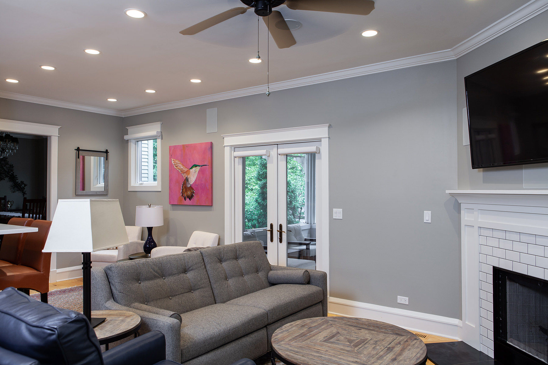 Medium gray walls and light wood flooring make for a classic, yet, modern look in this Libertyville home remodel.